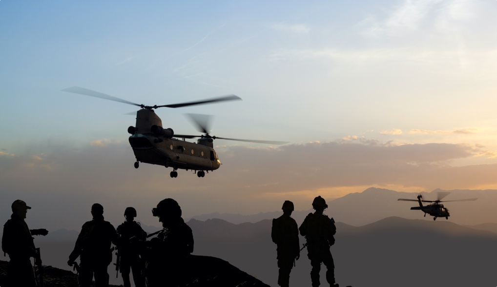 Helicopter landing near troops
